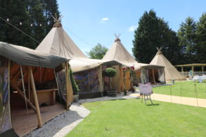 Tipis dressed for wedding, side view